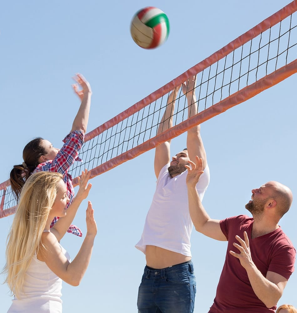 Group playing Volleyball